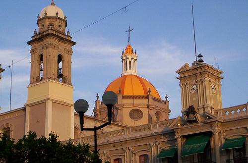 Colima cathedral lit up by the sunset